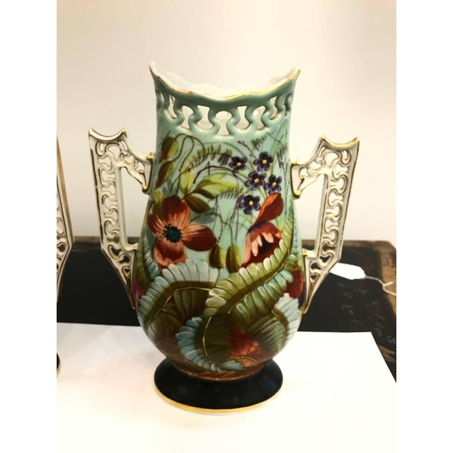 Vibrant pair of Old Paris porcelain botanical vases. Each one hand-painted and are a mirror image of each other. The...