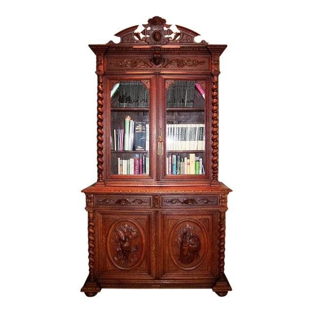 Early 19th Century French Provincial Highly Carved Oak Bookcase For Sale