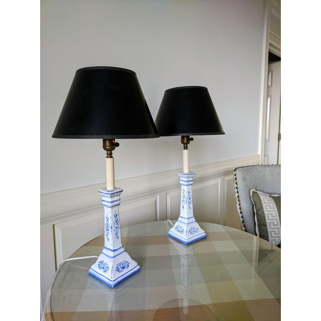 A pair of Vintage Hand Painted Blue and White Ceramic Buffet Lamps with Black Shades Made in Portugal Both Shades are...