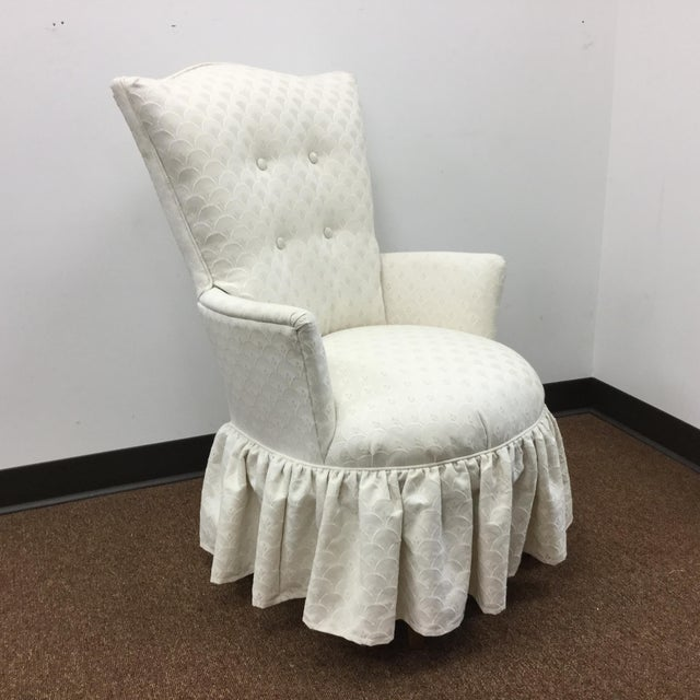 This is truly a lovely chair. It has so many outstanding features. First it's a perfect size as a Boudoir Slipper Chair....