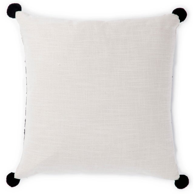 Fun and perfectly patterned, this Nikki Chu throw pillow adds global charm to contemporary reading nooks and sitting...