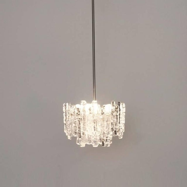 A very beautiful and elegant vintage chandelier, manufactured by Kalmar Austria in the 1960s. Lovely design, the...