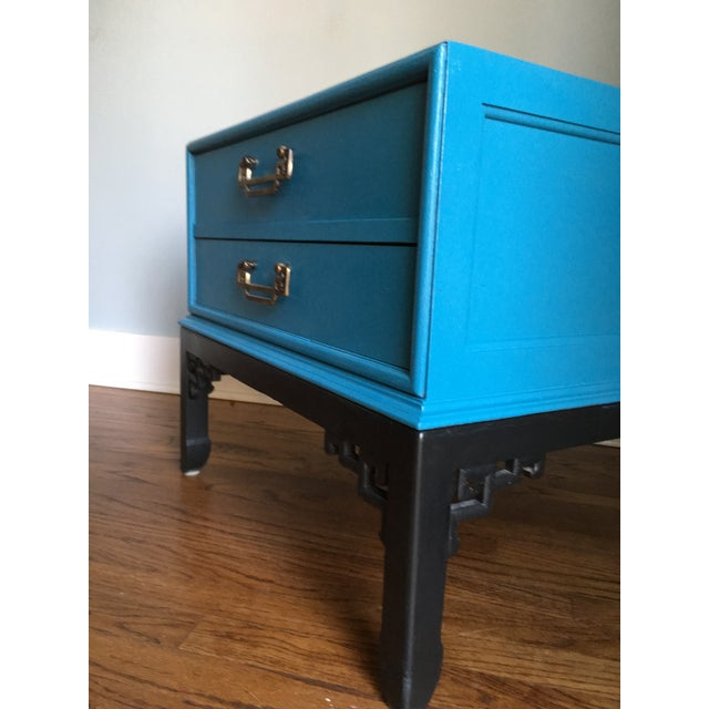Beautiful Blue Heckman side table with two drawers. Asian Accents on the legs in black. Drawers slide smoothly. This piece...