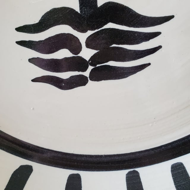 Vintage Picasso inspired Sunburst & Face pottery low bowl. The piece may also be used as a decorative wall hanging or...