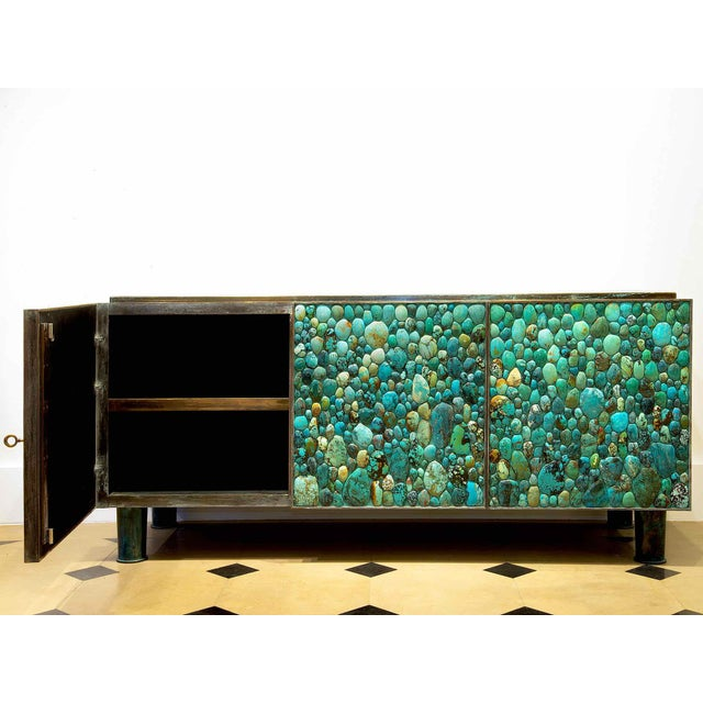 KAM TIN Turquoise Sideboard Turquoise cabochons, wood, patinated brass With Three opening doors France, 2013 This piece...