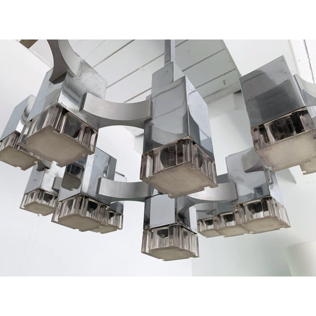 Chandelier or ceiling pendant light by the designer Gaetano Sciolari. The most iconic model of Sciolari in a seventeen...