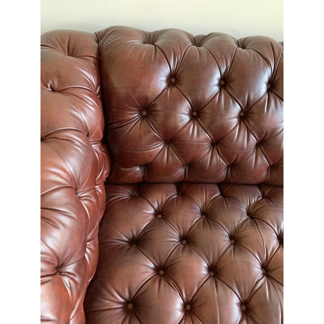 Vintage Chesterfield Leather Sofa! An English roll arm Chesterfield sofa in cognac leather is rich with sophistication and...