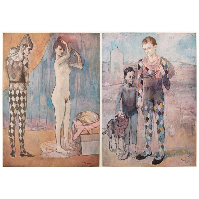 A gorgeous set of two original period tipped-in lithographs after watercolors The Harlequin's Family (1905) and Two...
