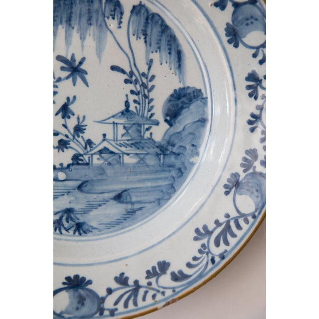 An antique 18th-Century Delft hand molded faience plate. This fine hand painted plate has a chinoiserie design with a...