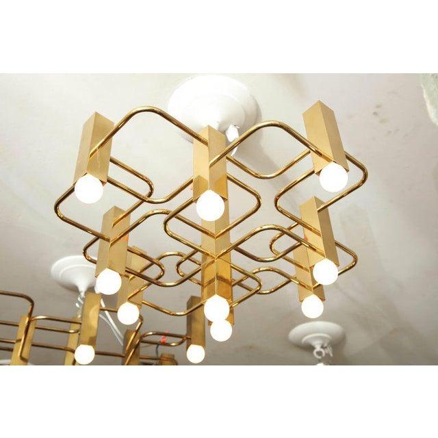Nine-arm Sciolari chandelier pendant in brass.