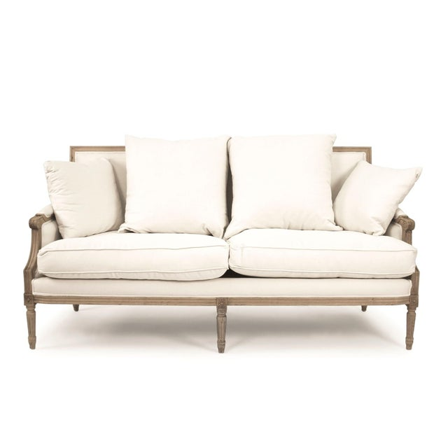 Louis sofa upholstered in white cotton on natural oak frame.