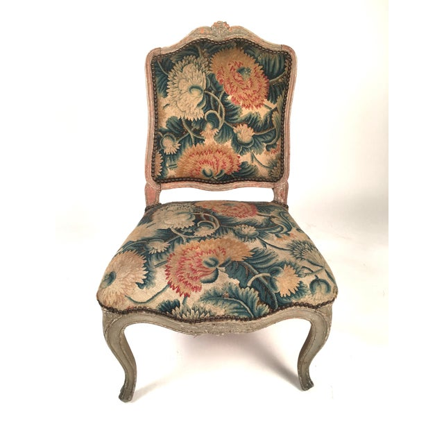 A set of 4 18th century French Louis XV chairs, upholstered with period floral needlework, with grey painted frames, the...