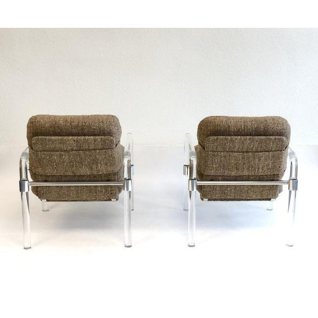 """A glamorous pair of clear acrylic and polish chrome """"Pipe Line Series 2"""" lounge chairs by Jeff Messerschmidt. Both chairs..."""