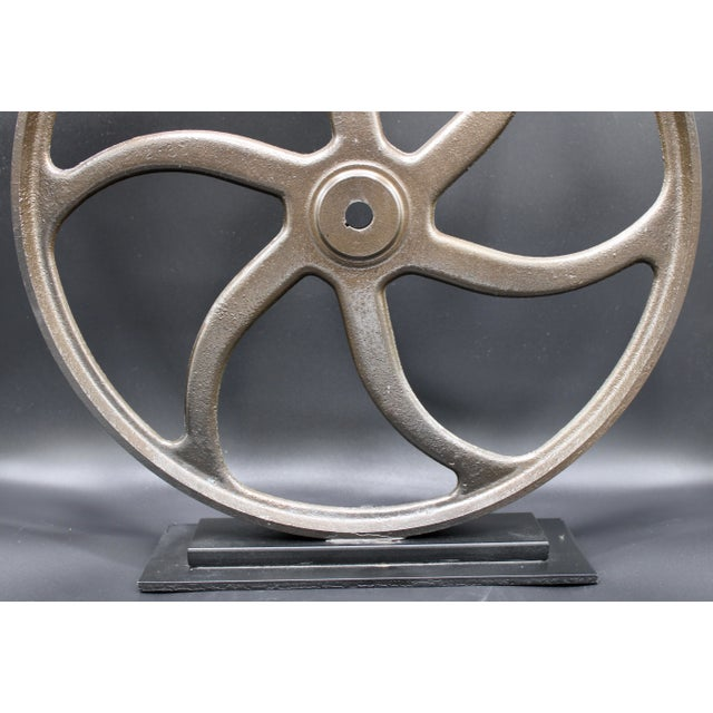 Vintage lathe wheel originally used for machining metal or shaping wood and other material by means of a rotating drive...