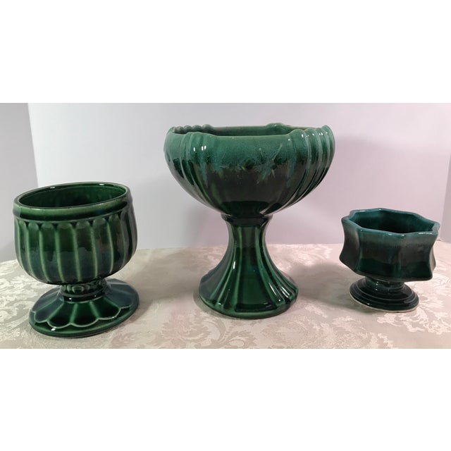 "Nice set of three green Drip Glaze Mid-Century Ceramic Planters. The large pedestal planter measures 7"" x 7"" x 7.75"" and..."