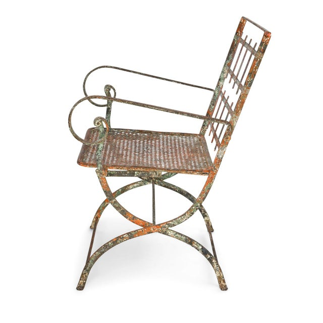 Pair of French iron garden chairs with traces of original paint (circa 1910). Chairs are sold together as a pair for $3,200.