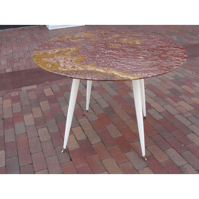 Perfect for Foyer, small dining space or a large gueridon, this amazing table attributed to Osvaldo Borsani, boasts an...