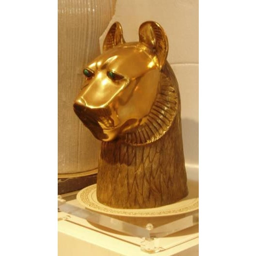 Bronze lion head with malachite eyes. From the Rudolf collection. Comes with lucite base and wood pedestal. Lucite...
