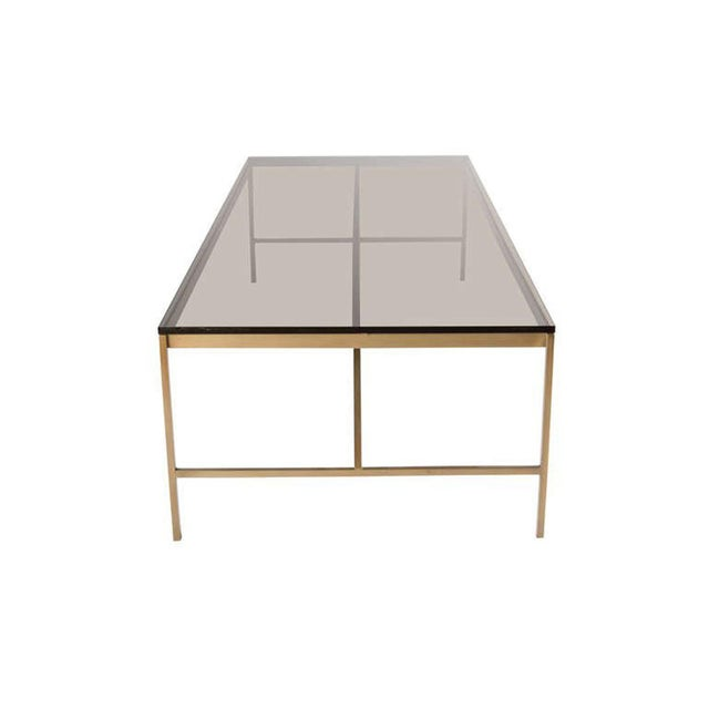 Thin Profile Brass Frame Cocktail Table with bronze glass top.Half inch square stock brass frame supports half inch bronze...