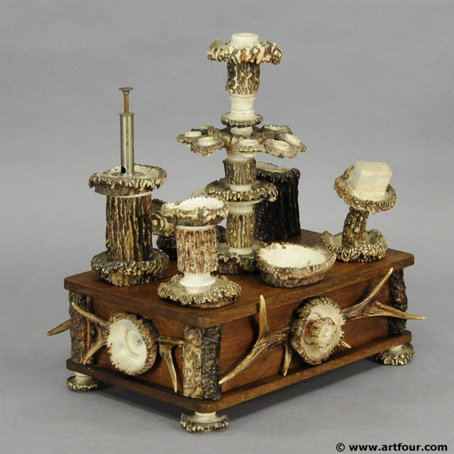a large elaborately handmade smokers stand. oak wood base with several smoking accessories like ashtray, candle sick,...