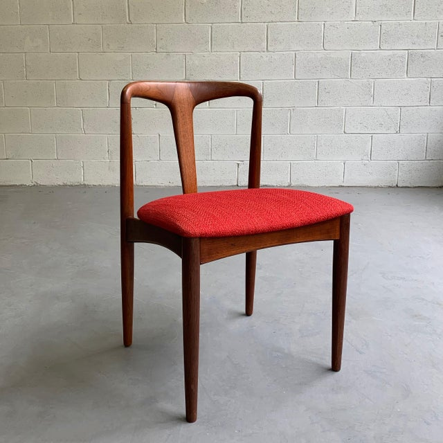 """Danish modern """"Juliane"""" side chair by Johannes Andersen features a sculptural, teak frame with newly upholstered seat."""