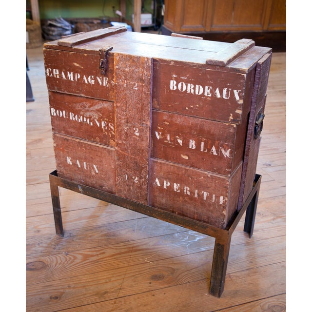 One of a kind antique champagne and wine shipping crates/ trunks with a new hand forged iron base. Excellent for storage...