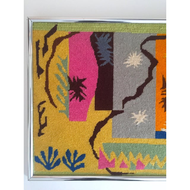 This vintage Mid Century Modern framed original hand needlepoint textile art piece is after the world famous French Modern...