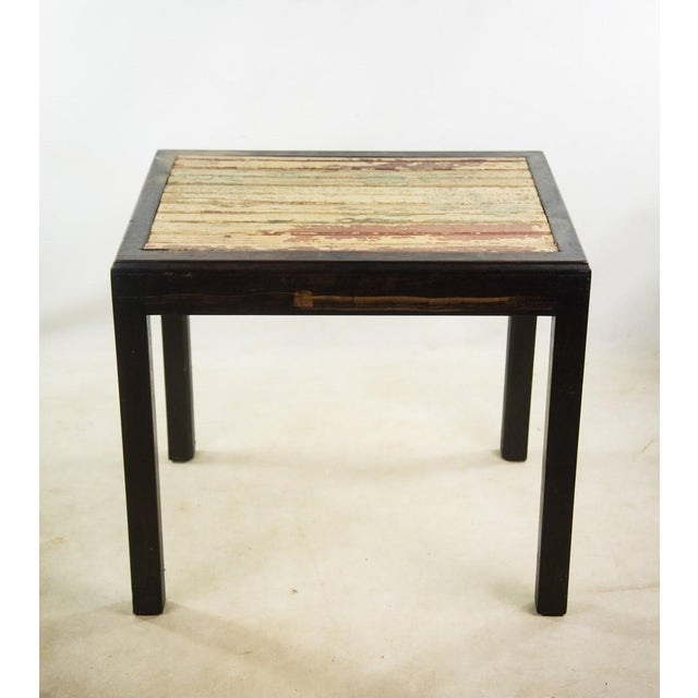 Bring a warm wood tone into your living space with this rustic reclaimed wood side table. The table top features reclaimed...