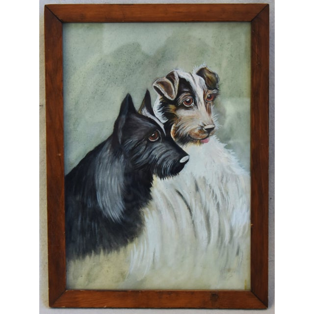 Midcentury watercolor on paper of a pair of dogs. Unsigned. Displayed under glass in a brown wood frame; hanging wire on...
