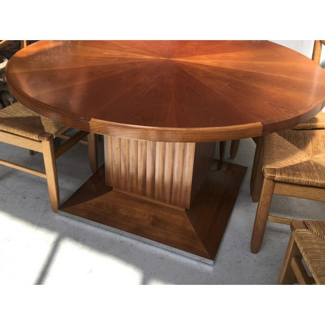 Lucien Rollin spectacular pure large round dinning table with central foot.