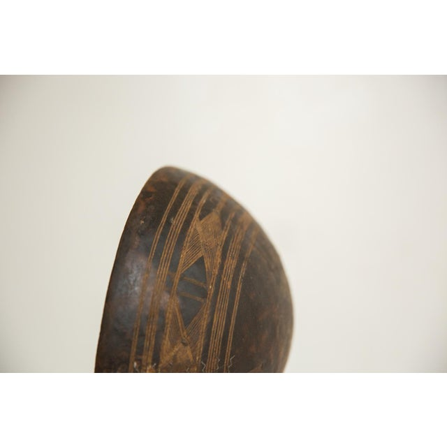 :: Hand-carved wood primitive vintage African bowl with tons of character and charm. Please note this is an aged and lived...