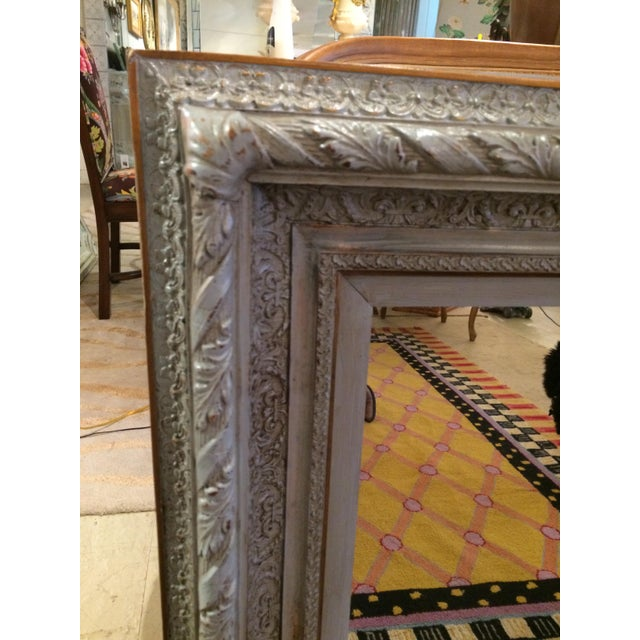 Very pretty rectangular carved wood mirror painted a soothing shade of grey with gold accents and a bevelled mirror.