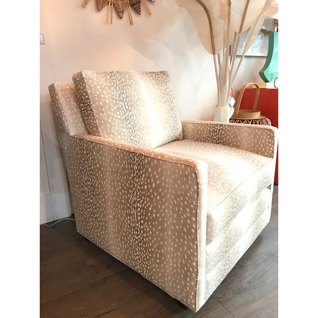 Beautiful upholstered club chair in a pretty doeskin fabric by MT Company. Track Arm, Loose Square Boxed Back, Straight...