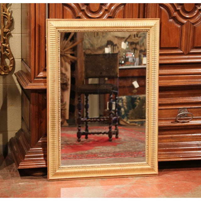 This elegant, antique wall mirror was crafted in Paris, France, circa 1860. The large, rectangular, carved wooden frame is...
