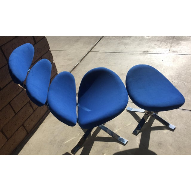 Mid century modern royal blue pedal chair with matching ottoman. In the style of the Corona Chair, Model EJ-5, by Poul M....