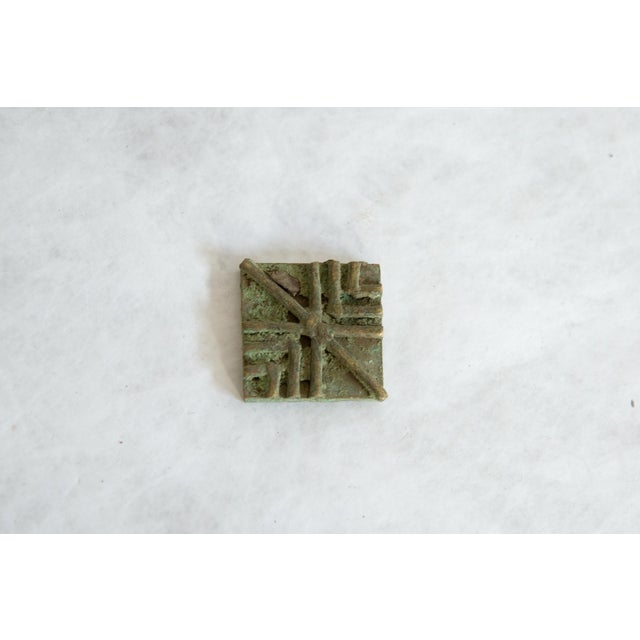 :: Vintage handmade African square oxidized bronze coin. Circa mid 20th century and possibly older, this piece has such...