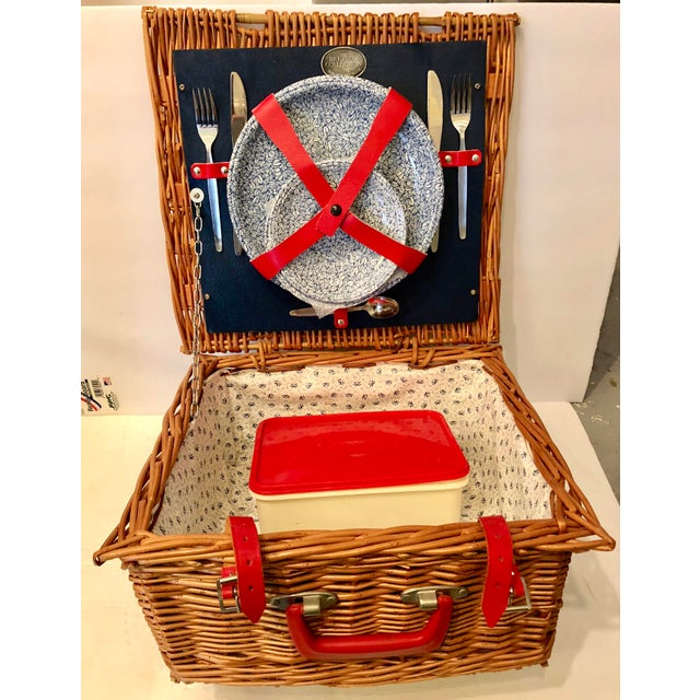 Brexton picnic basket made in England. It has place settings for two. Plates are dishwasher safe. The utensils are...