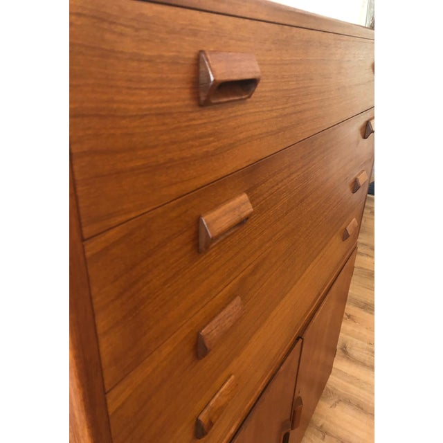 Larger dresser cabinet rests atop a credenza. Adjustable shelving, dovetail construction, refreshed finish.