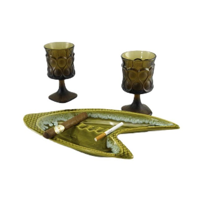 """Hand-glazed mid-century modern boomerang shaped ashtray. Marked """"USA"""" on the base. Circa 1960's. Mossy olive green with a..."""