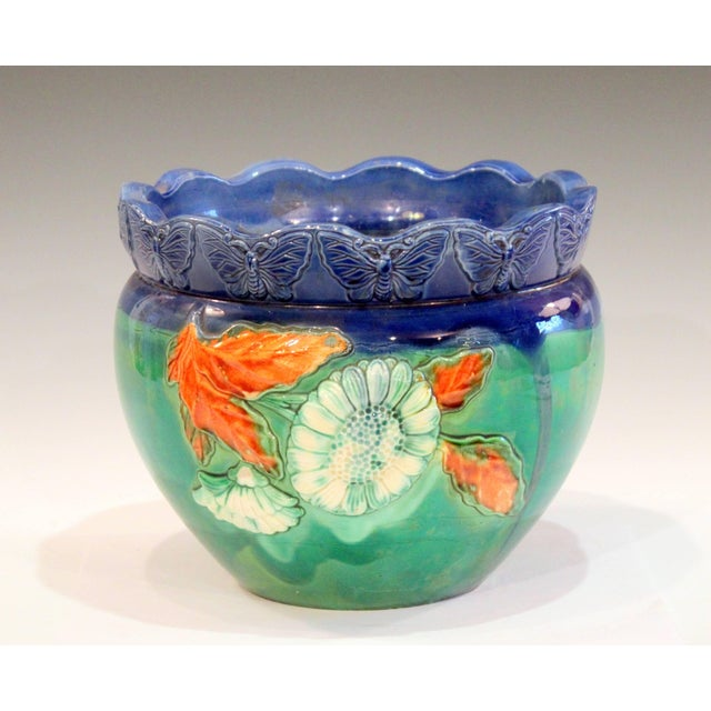 Vintage, handmade Awaji Pottery jardiniere with applied decoration of blooming flowers and a band of butterflies at the...