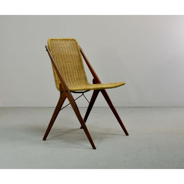 Elegant Dutch Design Wicker chair after the style of Dirk van Sliedregt. The minimalist mid century designed side chair is...