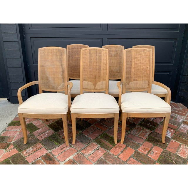 Beautifully constructed of blond hardwood with tall finely caned backs, this set of six dining chairs includes two...