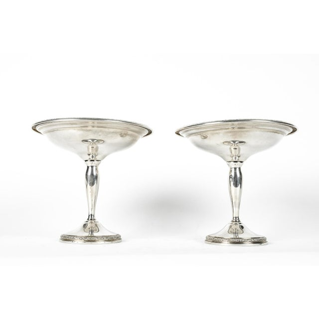 Pair of vintage sterling silver dessert compotes / candy dish holder with decorative rims. Each sterling compote measure...