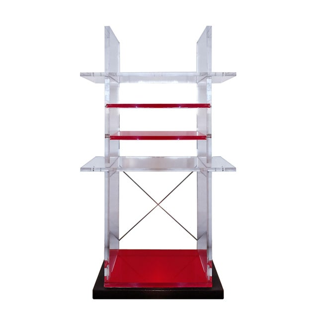 Pair of bookcases with cast iron base, transparent and red thick plexiglas stands and shelves, nickel plated cross-brace...