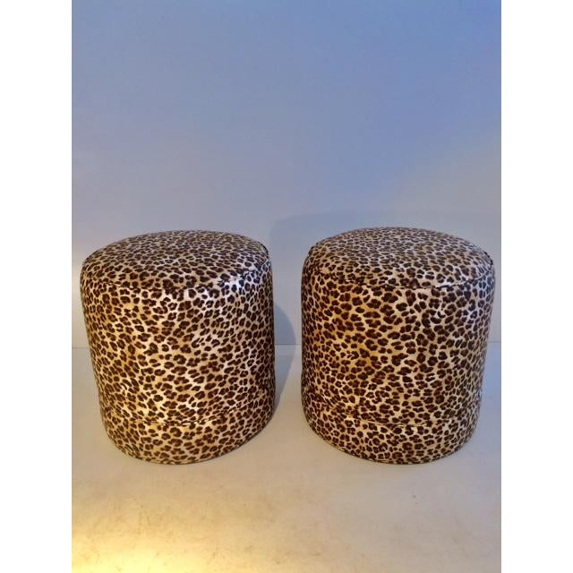Pair of Todd Hase Ruth Ottomans upholstered in Todd Hase textiles silk screened leopard print. Fun addition to any room.