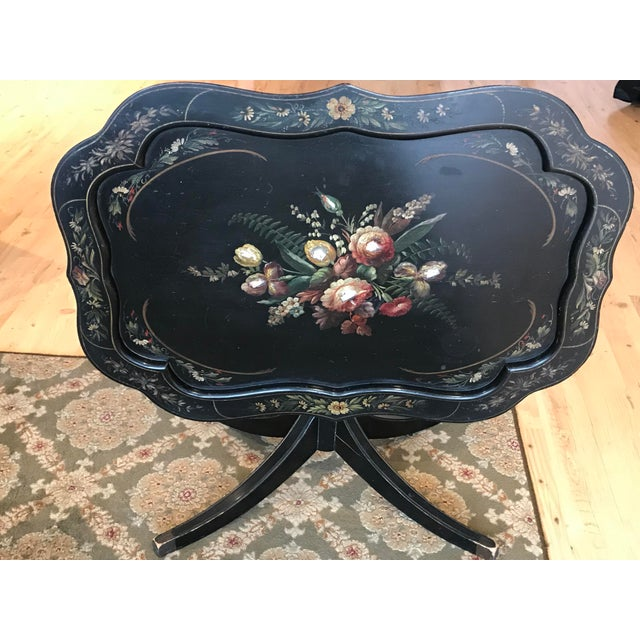 """Vintage tole painted tray table that tilts. Measures 30.5""""L x 22""""W x 18.5""""H. Top has double step curved edging with hand-..."""