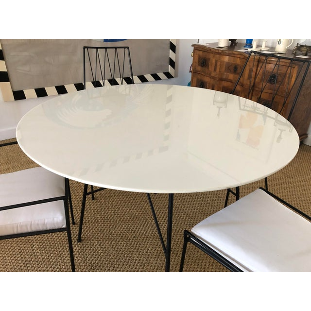 A Paul McCobb for Arbuck Pavilion Collection table and 4 chairs in wrought iron and milk glass, with newly upholstered...