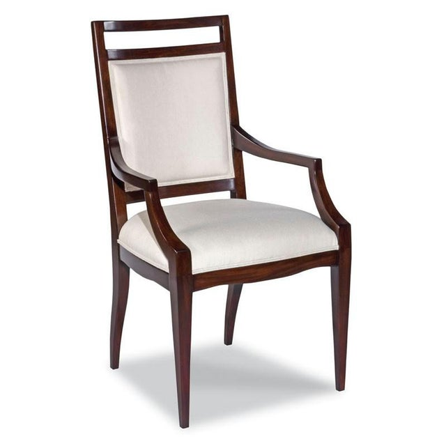 Gracefully tapering legs elevate an upholstered seat and back with welt trim. Material: Hardwood solids