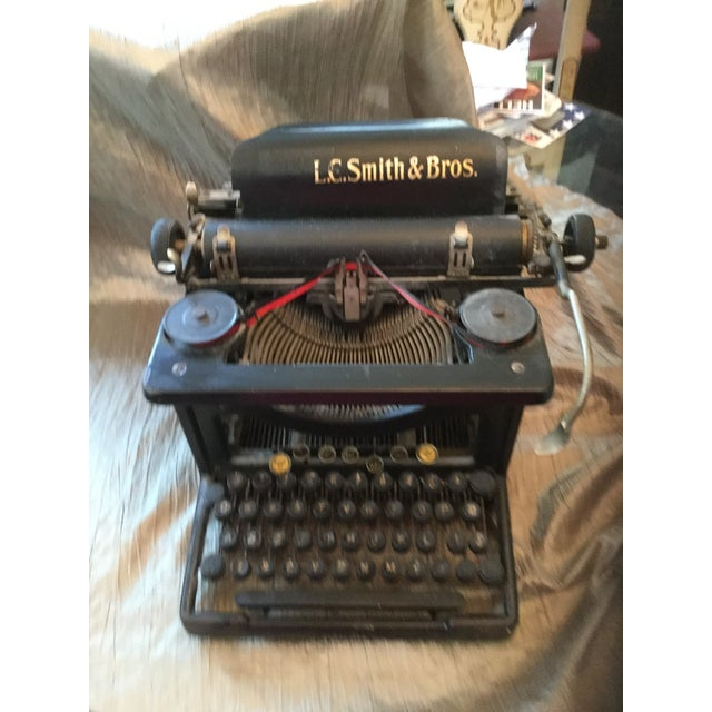 This wonderful typewriter is a sample of the early Industrial Age movement. It is a great way to accent a room with a...