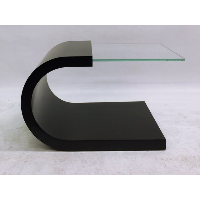 Waterfall black lacquer and glass end table. A great modern piece to add to your decor.